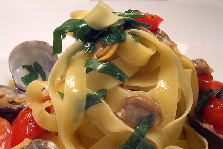 Pasta - fettucine vongole with cherry tomatoes and fresh herbs